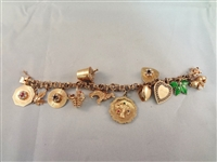 14k Gold Charm Bracelet with 12 14k gold charms