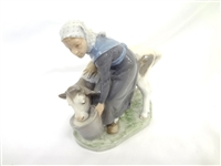 "Royal Copenhagen ""Milkmaid with Dairy Calf"" #779"