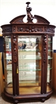 Styled After R.J. Horner Bevel Demilune Curio Cabinet Putti Finial Center