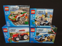 (4) LEGO Unopened Sets: 4436 Patrol Car, 7279 Police Minifig Collection, 60053 Race Car, 7634 Tractor